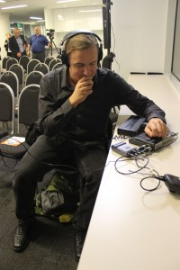 Video Producer checks audio levels for live roundtable event at Pan's downtown Boston office.