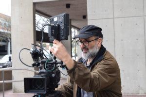 videographer shoots b-roll outside