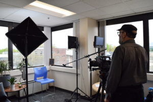 setting up lighting before interview