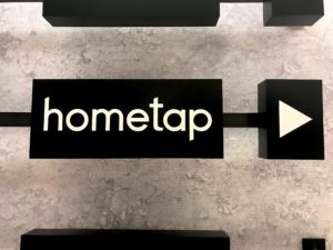 Hometap logo in office