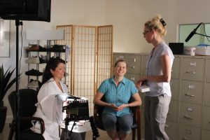 boston video production agency owner, christina skillman, prepping clients at a shoot